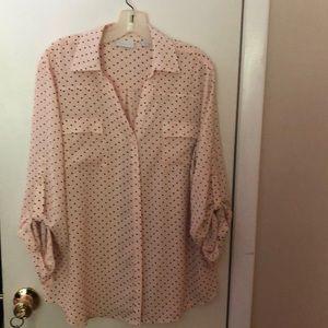 Pretty in pink polkadot blouse.